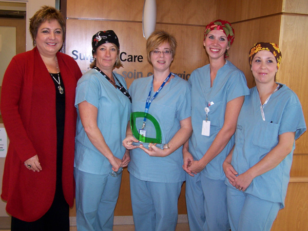 Surgical team with Booth award) Caption: KDH Surgical Care Unit staff holding the Booth Centennial Green Award. Left to right: Cathy Watson, Debbie Thurler, Julie Summers, Lindsay Essar, Joanne Rheaume