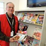 volunteer with magazines