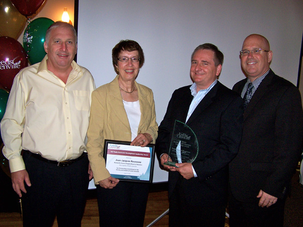 KDH Board of Directors Chair Jean-Jacques Rousseau (second from right) accepts the Bill Thake Economic Development Award on behalf of the Board. Also pictured, Dermid O'Farrell (far left), Chair of the KDH Foundation Board, Lis Angus (second from left), Vice Chair of the KDH Board of Directors, and Steve Clark (far right), Leeds and Grenville MPP.