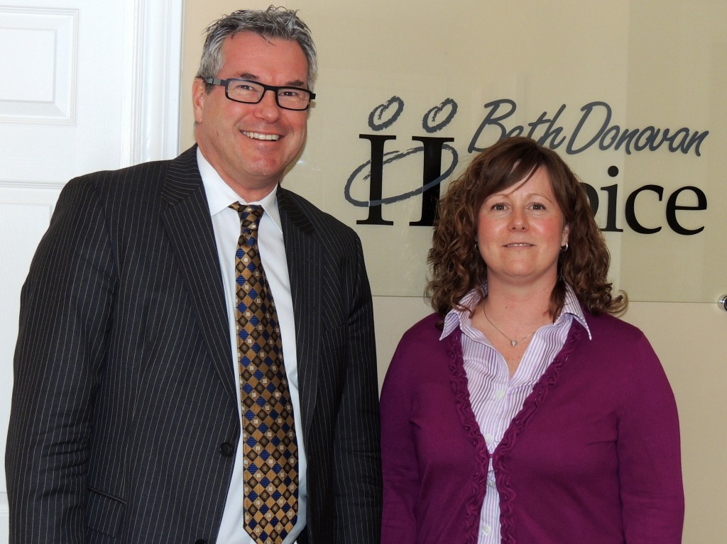 KDH CEO Colin Goodfellow congratulates Dawn Rodger, Executive Director of Beth Donovan Hospice, on the Hospice's move to 25 Hilltop Crescent, Kemptville.