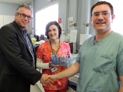 KDH CEO Colin Goodfellow (left) thanks lab staff Joanna Melesky and Jesse Trousdale for their efforts